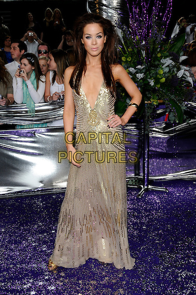 ROXANNE McKEE .of Hollyoaks.Attending the British Soap Awards 2008.BBC Television Centre, Wood Lane, London, England, 3rd May 2008.full length gold sequined dress low cut plunging neckline hand on hip.CAP/CAN.© Can Nguyen/Capital Pictures