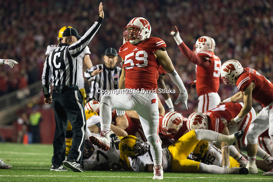 Wisconsin Badgers linebacker Marcus Trotter (59) celebrates during an NCAA Big Ten Conference football game against the Minnesota Golden Gophers Saturday, November 29, 2014, in Madison, Wis. The Badgers won 34-24. (Photo by David Stluka)