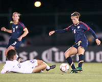 Carli Lloyd (11) of USA pulls the ball in as Lee Eun Mi (22) of South Korea slides in during an international friendly match at City Stadium on November 1, 2008 in Richmond, Virginia. USA won 3-1. Photo by Tony Quinn / isiphotos.com