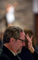 A man has ashes applied to his head during Ash Wednesday services. Photo Copyright Gary Gardiner. Not be used without written permission detailing exact usage.