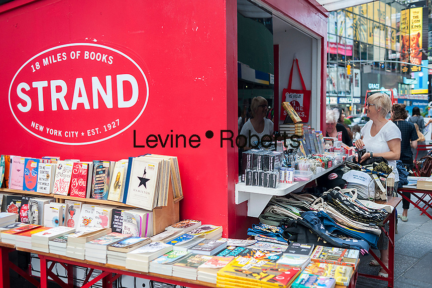 Customers browse books and novelties at a satellite of the famous Strand bookstore in Times Square in New York on Tuesday, August 2, 2016. (© Frances M. Roberts)