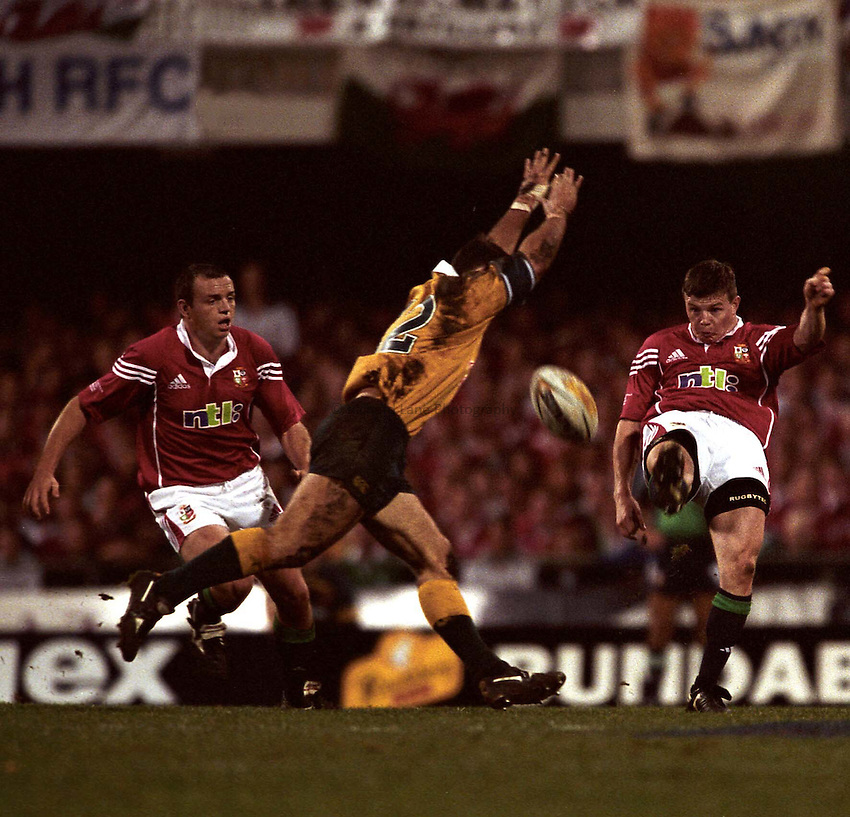 Photo. Richard Lane. .Lions Tour 2001. First Test, Australia v The Lions at the Gabba, Brisbane, Australia. 30/6/2001.Brian O'Driscoll clears as Nathan Grey attempts to charge down.