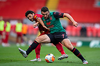 5th July 2020, Anfield, Liverpool, England;  Liverpools Alex Oxlade-Chamberlain held off by Aston Villas John McGinn during the Premier League match between Liverpool and Aston Villa at Anfield in Liverpool