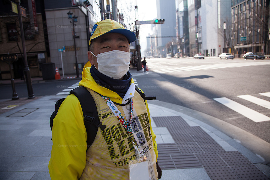 Portrait of a volunteer race official before the start of the 10th Tokyo Marathon took place on a fine spring day in Tokyo Japan. Sunday February 28th 2016. Thirty-six thousand runners took part with Ethiopian,  Feyisa Lilesa winning the  men's competition and  Kenyan, Helah Kiprop victorious in the women's race.