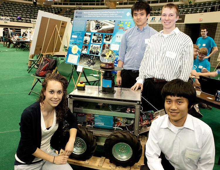 Displaying their mechanically controlled snoiw plow are Samantha Craig, Kuangmin Li Ryan Kollar and Pengfez Duan.