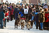 Lance Mackey runs through a crowd down Front Street in Nome to the finish line as winner of the 2010 Iditarod Sled Dog Race, Arctic Alaska