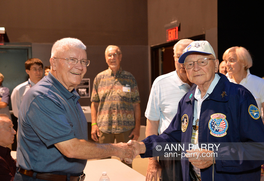 Former NASA Apollo astronaut FRED HAISE, at left, is shaking hands with ERNIE FINAMORE, 88, of Massapequa Park, at a Summer of '69 Celebration Event held at the Long Island Cradle of Aviation Museum, on the 45th Anniversary of NASA Apollo 11 LEM landing on the moon July 20, 1969. Finamore, was a QC Quality Control inspector for the Lunar Excursion Module from 1965 to 1971. Haise, the lunar module pilot for Apollo 13 mission, was in the LEM Room during the reunion of former Northrop Grumman Aerospace Corporation employees.