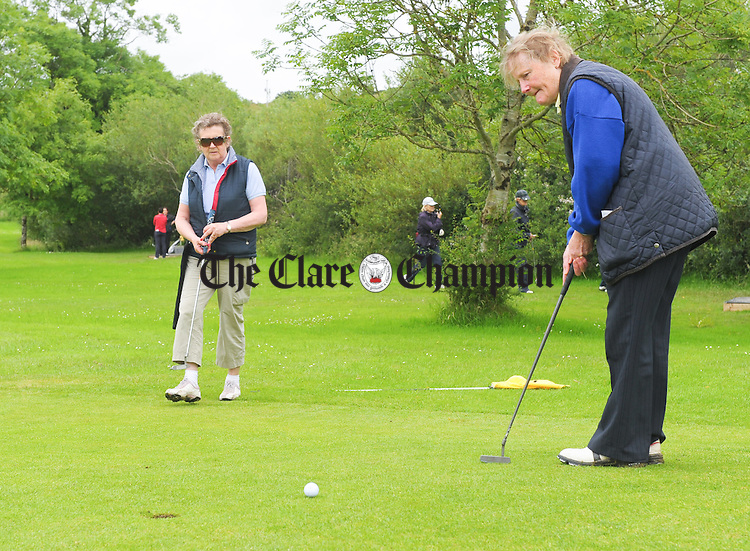 Kilnamona's Mary Marrinan putting watched by Maureen Witcher during the Munster Ladies Pitch And Putt Stroke Play Championships at Kilnamona. Photograph by John Kelly..