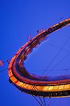 A slow shutter speed blurs the motion of the roller coaster at the Montgomery County Agricultual Fair in Gaithersburg, Maryland.