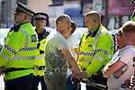 © Joel Goodman - 07973 332324 . No syndication permitted . 26/08/2013 . Bolton , UK . Police detain an EDL supporter ahead of the demonstration . The English Defence League hold a demonstration in Farnworth Park , Bolton , today (26th August 2013) . Photo credit : Joel Goodman