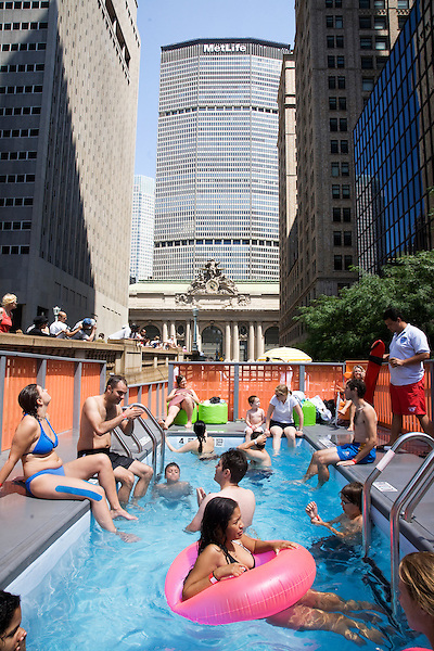 "New Yorkers ""dumpster dive"" in swimming pools made out of dumpsters on Park Avenue near Grand Central Station on 07 August 2010.  People were allowed 20-minute turns swimming in any of the three ""dumpster pools."""
