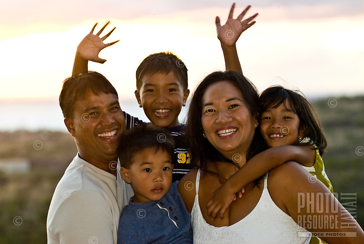 Local part Hawaiian family with mom, dad and three young children