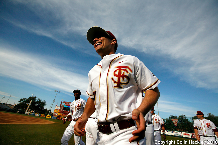 TALLAHASSEE, FL 10-FSU-GA.ST. BASE10 CH05-Florida State's Parker Brunelle breaks into a smile as he runs to the dugout for the start of the season opener against Georgia State Friday at Dick Howser Stadium in Tallahassee. The Seminoles beat the Panthers 11-3...COLIN HACKLEY PHOTO
