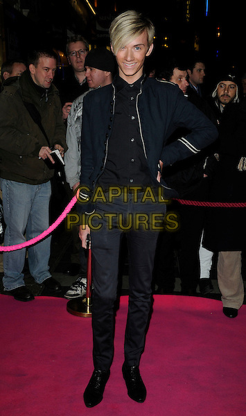 HARRY DERBRIDGE.Press night for 'My Trip Down The Pink Carpet' at the Apollo Theatre, Shaftesbury Avenue, London, England..February 3rd 2011.full length black jacket hand on hip grey gray trousers military  .CAP/CAN.©Can Nguyen/Capital Pictures.
