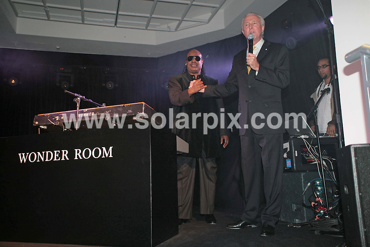 **ALL ROUND PICTURES FROM SOLARPIX.COM**.**NO UK NEWSPAPER PUBLICATION **UK MAGAZINE PUBLICATION ONLY** AND NO PUBLICATION IN FRANCE, SCANDINAVIA, AUSTRALIA AND GERMANY** .Invited guests enjoy a private performance by Stevie Wonder this evening as he played a live set in the Wonder Room in Selfridges in London. 20th November 2007..This pic: Stevie Wonder and Galen Weston..JOB REF: 5369 SFE       DATE: 20_11_2007.**MUST CREDIT SOLARPIX.COM OR DOUBLE FEE WILL BE CHARGED* *UNDER NO CIRCUMSTANCES IS THIS IMAGE TO BE REPRODUCED FOR ANY ONLINE EDITION WITHOUT PRIOR PERMISSION*