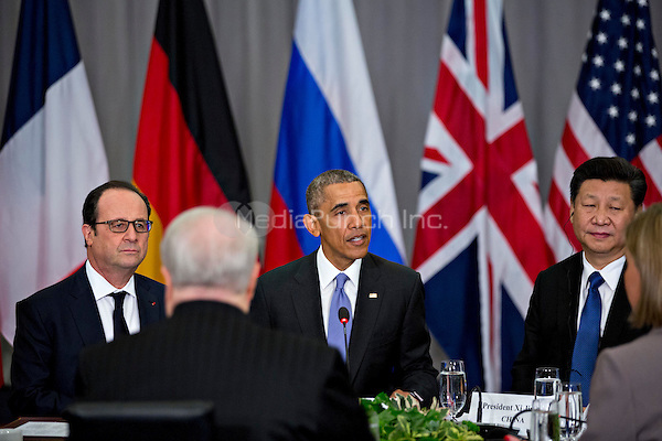 United States President Barack Obama, center, speaks as Xi Jinping, China's president, right, and Francois Hollande, France's president, left, listen during a P5+1 multilateral meeting at the Nuclear Security Summit in Washington, D.C., U.S., on Friday, April 1, 2016. After a spate of terrorist attacks from Europe to Africa, Obama is rallying international support during the summit for an effort to keep Islamic State and similar groups from obtaining nuclear material and other weapons of mass destruction. <br /> Credit: Andrew Harrer / Pool via CNP/MediaPunch
