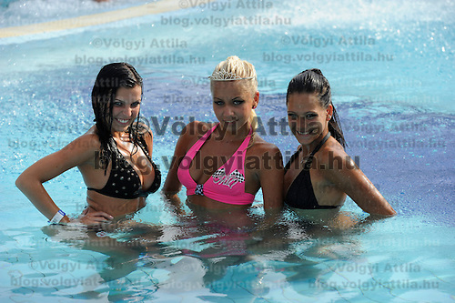Evelin Szalai (L), Szilvia Kalman (C) and Angela Toth (R) pose for photographers after the Miss Bikini Hungary beauty contest held in Budapest, Hungary on August 06, 2011. ATTILA VOLGYI