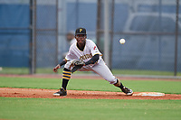 GCL Pirates second baseman Edgar Barrios (15) stretches for a throw while covering first base during a Gulf Coast League game against the GCL Rays on August 7, 2019 at Charlotte Sports Park in Port Charlotte, Florida.  GCL Rays defeated the GCL Pirates 5-3 in the second game of a doubleheader.  (Mike Janes/Four Seam Images)