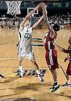 Florida International University guard Manuel Nunez (00) plays against Troy University, which won the game 75-70 in overtime on February 23, 2012 at Miami, Florida. .