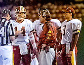 Washington Redskins quarterback Brad Johnson (14) meets head coach Norv Turner on the sidelines of the game against the New York Giants at Giants Stadium in East Rutherford, New Jersey on September 24, 2000.  Back-up quarterback Jeff George (3) looks on from the right.  The Redskins won the game 16 - 6.<br /> Credit: Arnie Sachs / CNP