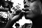 Dourados, Guarani reserve. Ernesto, 17 years old, smoking with his friends.