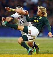 Tom Curry of England  looks to block Faf de Klerk of South Africa during the 2018 Castle Lager Incoming Series 2nd Test match between South Africa and England at the Toyota Stadium.Bloemfontein,South Africa. 16,06,2018 Photo by Steve Haag / stevehaagsports.com