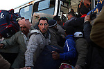 Foreign nationals crowd onto a bus bound for Tunis, after crossing into Tunisia at the border crossing with Libya near Ben Guerdane, Tunisia, Thursday, Feb. 24, 2011. Foreign nationals, including many Egyptian workers, fled Libya as Col. Muammar Qaddafi tried to maintain his grip on the capital Tripoli. In the latest uprising to strike the Middle East, street protests which began in Eastern Libya spread to Tripoli, as opposition members called for Qaddafi to follow Tunisian president Zine el-Abidine Ben Ali and Egyptian president Hosni Mubarak and step down.