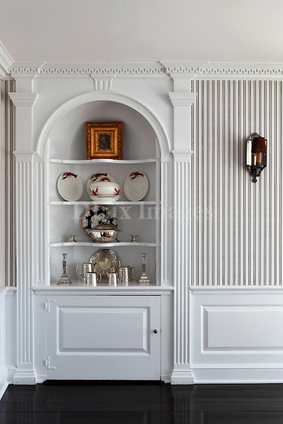 decorative objects in a white cabinet