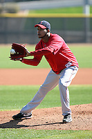 Ervin Santana #54 of the Los Angeles Angels participates in pitchers fielding practice during spring training workouts at the Angels complex on February 16, 2011  in Tempe, Arizona. .Photo by:  Bill Mitchell/Four Seam Images.