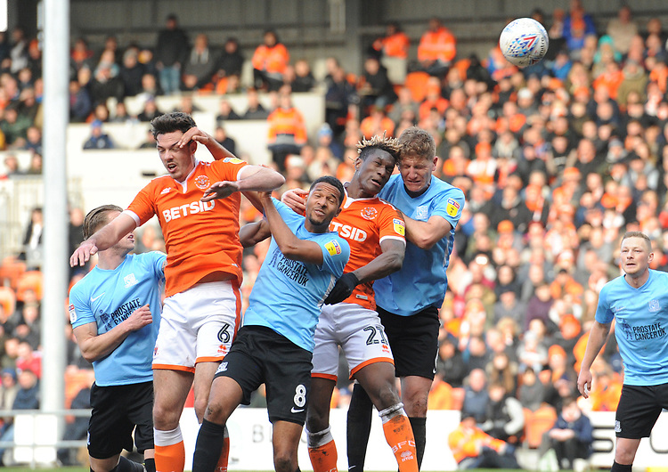Blackpool's Armand Gnanduillet vies for possession with Southend United's Michael Turner<br /> <br /> Photographer Kevin Barnes/CameraSport<br /> <br /> The EFL Sky Bet League One - Blackpool v Southend United - Saturday 9th March 2019 - Bloomfield Road - Blackpool<br /> <br /> World Copyright © 2019 CameraSport. All rights reserved. 43 Linden Ave. Countesthorpe. Leicester. England. LE8 5PG - Tel: +44 (0) 116 277 4147 - admin@camerasport.com - www.camerasport.com