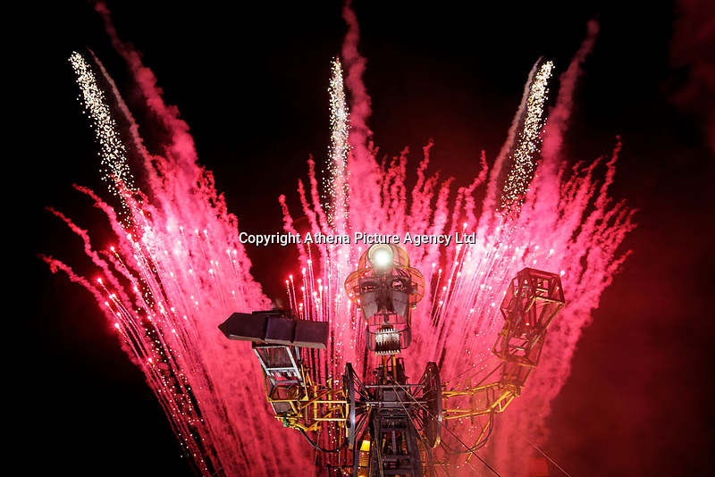 Pictured: Fireworks behind The Man Engine at the Copper Works in Morfa, Swansea, Wales, UK. Thursday 12 April 2018<br /> Re: The largest mechanical puppet in Britain starts its tour across south Wales.<br /> Man Engine, a mechanical miner which measures 36ft (11m) tall, has appeared at the Waterfront Museum and the former Copper Works in Swansea, Wales, animated by a dozen handlers.<br /> The giant is visiting areas linked to the nation's industrial past.