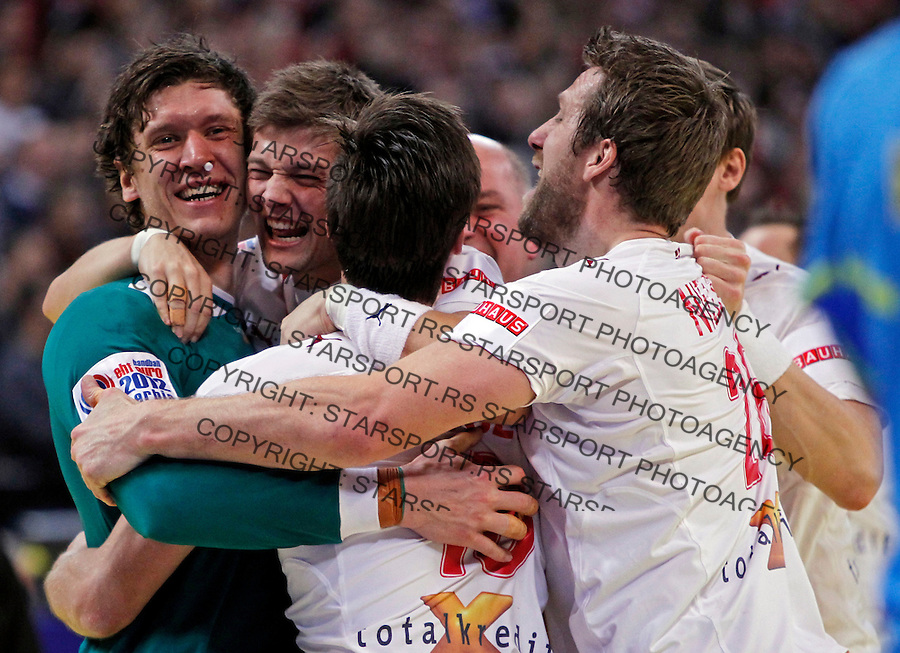 Niklas Landin Jacobsen and other Denmark handball players celebrate victory in final men`s EHF EURO 2012 handball championship game against Serbia in Belgrade, Serbia, Sunday, January 29, 2011.  (photo: Pedja Milosavljevic / thepedja@gmail.com / +381641260959)