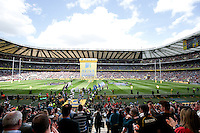 The Saracens and Bath Rugby teams run out onto the field. Aviva Premiership Final, between Bath Rugby and Saracens on May 30, 2015 at Twickenham Stadium in London, England. Photo by: Rogan Thomson for Onside Images