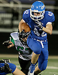 SIOUX FALLS, SD - OCTOBER 23: Keegan VanEgdom #42 from Sioux Falls Christian looks for room past Ethan Schallenkamp #57 from McCook Central Montrose in the first half of their game Thursday night at Bob Young Field. (Photo by Dave Eggen/Inertia)