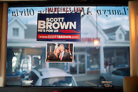 Campaign signs and images from the campaign trail hang on windows of the campaign bus of Senator Scott Brown (R-MA) in Framingham, Massachusetts, USA, on Thurs., Nov. 2, 2012. Senator Scott Brown is seeking re-election to the Senate.  His opponent is Elizabeth Warren, a democrat.