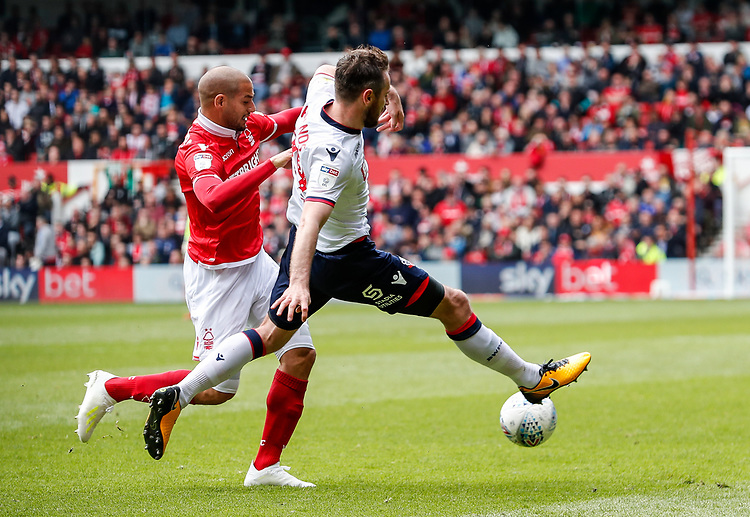 Bolton Wanderers' Jonathan Grounds competing with Nottingham Forest's Adlene Guedioura <br /> <br /> Photographer Andrew Kearns/CameraSport<br /> <br /> The EFL Sky Bet Championship - Nottingham Forest v Bolton Wanderers - Sunday 5th May 2019 - The City Ground - Nottingham<br /> <br /> World Copyright © 2019 CameraSport. All rights reserved. 43 Linden Ave. Countesthorpe. Leicester. England. LE8 5PG - Tel: +44 (0) 116 277 4147 - admin@camerasport.com - www.camerasport.com