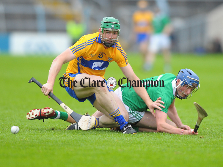 Fergal Lynch of Clare in action against Gavin O Mahoney of Limerick during their game at Semple Stadium. Photograph by John Kelly.