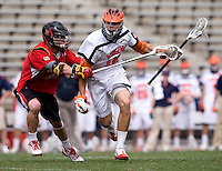 John Haldy (12) of Virginia holds the ball away from  Bryn Holmes (17) of Maryland during the ACC men's lacrosse tournament finals in College Park, MD.  Virginia defeated Maryland, 10-6.
