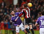 Gary Madine of Bolton Wanderers and John Lundstram of Sheffield Utd  during the Championship match at Bramall Lane Stadium, Sheffield. Picture date 30th December 2017. Picture credit should read: Simon Bellis/Sportimage