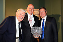 WOBURN, ENGLAND - AUGUST 30:  Peter Fowler of Australia receives the John Jacobs Trophy for winning the Order of Merit from John Jacobs and George O'Grady, Chief Executive of the European Tour at the annual awards dinner held at Woburn Abbey prior to the Travis Perkins plc Senior Masters played at the Duke's course, Woburn Golf Club on August 30, 2012 in Woburn, United Kingdom.  (Photo by Phil Inglis/Getty Images) *** Local Caption *** Peter Fowler; John Jacobs; George O'Grady
