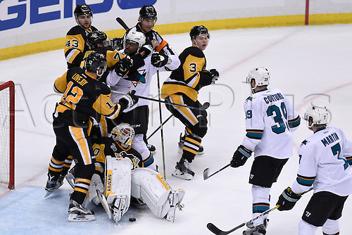01.06.2016. Pittsburgh, Penn, USA.  Pittsburgh Penguins goalie Matt Murray (30) protects the puck under his pads with San Jose Sharks right wing Joel Ward (42) in front and Pittsburgh Penguins right wing Patric Hornqvist (72) and defenseman Olli Maatta (3) defending during the third period. The Pittsburgh Penguins won 2-1 in overtime against the San Jose Sharks in Game Two in the 2016 NHL Stanley Cup Final at the Consol Energy Center in Pittsburgh, Pennsylvania.