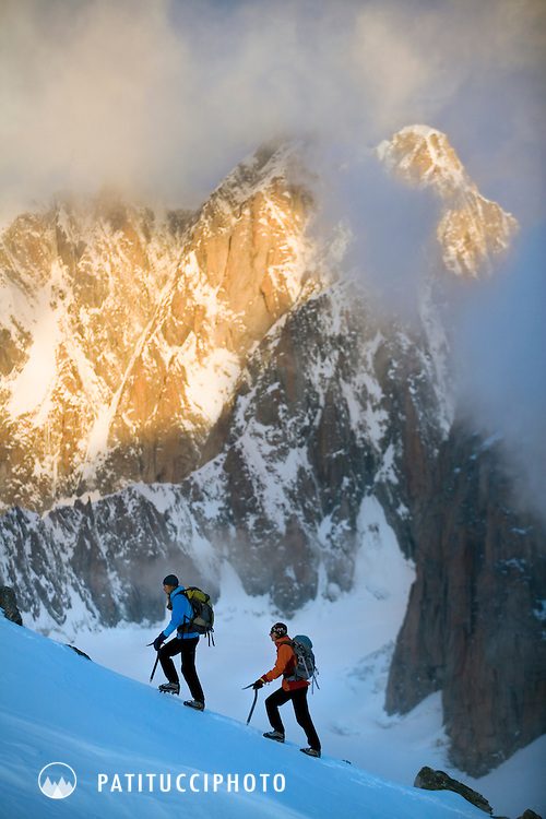 Amy Rasic and Janine Patitucci approaching the Aiguille d'Entreves at sunrise as the first light hits the Mont Blanc Massif