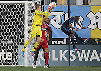 CHESTER, PA - AUGUST 12, 2012:  Zac MacMath (18) of the Philadelphia Union saves from  Marco Pappa (16) of the Chicago Fire during an MLS match at PPL Park, in Chester, PA on August 12. Fire won 3-1.