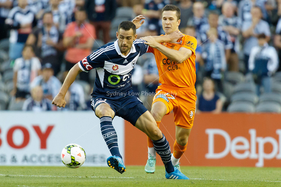 Carl VALERI of the Victory defends the ball in the round seven match between Melbourne Victory and Brisbane Roar in the Australian Hyundai A-League 2014-15 season at Etihad Stadium, Melbourne, Australia.