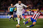 Daniel Carvajal Ramos of Real Madrid fights for the ball with Stefan Savic of Atletico de Madrid during their La Liga match between Atletico de Madrid and Real Madrid at the Vicente Calderón Stadium on 19 November 2016 in Madrid, Spain. Photo by Diego Gonzalez Souto / Power Sport Images