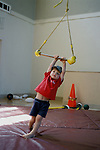 Albany, Ca Boy, four years old, playing with trapeze at preschool gymnastics program  MR