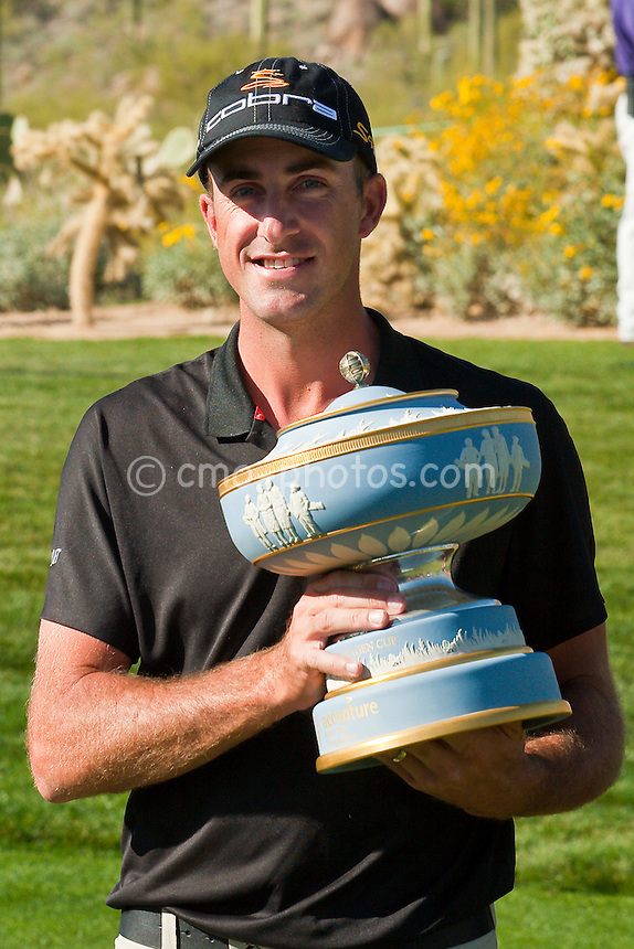Mar 1, 2009; Marana, AZ, USA; Geoff Ogilvy (AUS) holds the Walter Hagen Cup after his 4 and 3 victory over Paul Casey (ENG), not pictured, in the World Golf Championships-Accenture Match Play Championship at the Ritz-Carlton Golf Club, Dove Mountain.  The win this week brought Ogilvy's career record in this event to 17-2 with two victories.