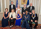 The five recipients of the 38th Annual Kennedy Center Honors pose for a group photo following a dinner hosted by United States Secretary of State John F. Kerry in their honor at the U.S. Department of State in Washington, D.C. on Saturday, December 5, 2015.  The 2015 honorees are: singer-songwriter Carole King, filmmaker George Lucas, actress and singer Rita Moreno, conductor Seiji Ozawa, and actress and Broadway star Cicely Tyson.  From left to right top: United States Secretary of State John Kerry; Rita Moreno; George Lucas; and David M. Rubenstein, Chairman, John F. Kennedy Center for the Performing Arts.  From left to right bottom: Deborah F. Rutter, President, John F. Kennedy Center for the Performing Arts; Teresa Heinz-Kerry; Carole King; Cicely Tyson; and Seiji Ozawa.<br /> Credit: Ron Sachs / Pool via CNP