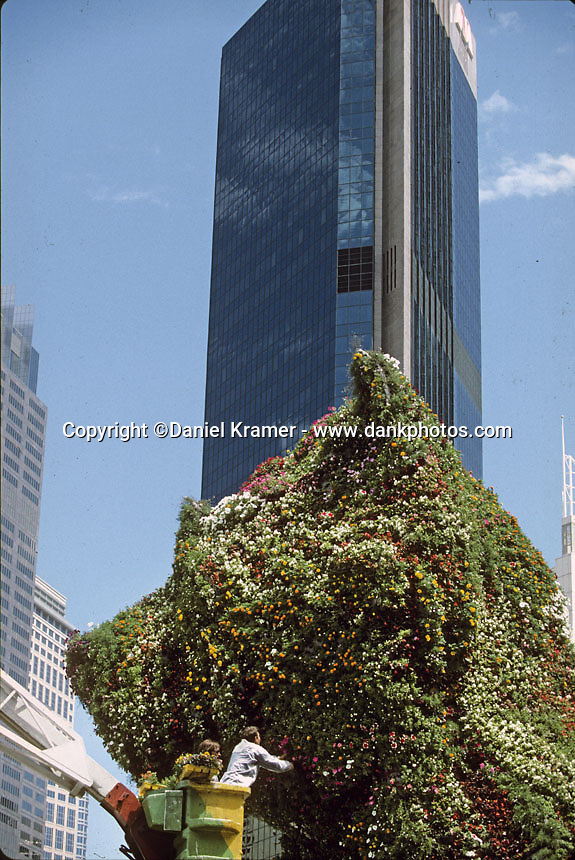 "Jeff Koons works on his ""Puppy"" at the Museum of Contemporary Art in Sydney, Australia in 1995. Topiary is an old-fashioned form of gardening art that goes back to Roman times. This was the first of Koons' public arts projects and this piece now stands outside the Guggenheim museum in Bilbao."