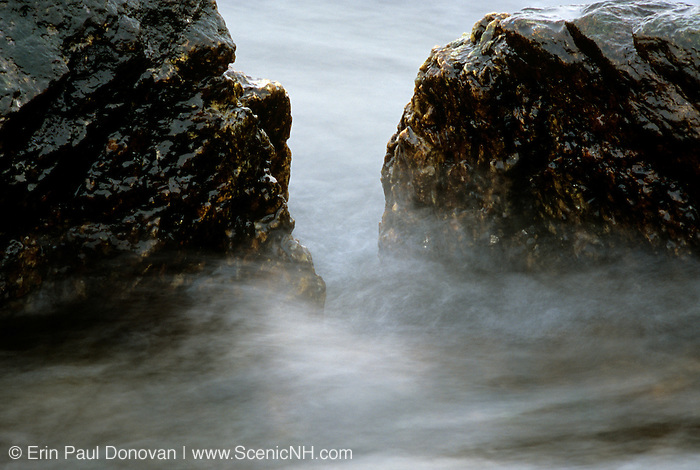 Waves crashing over rocks along the New Hampshire USA coast.